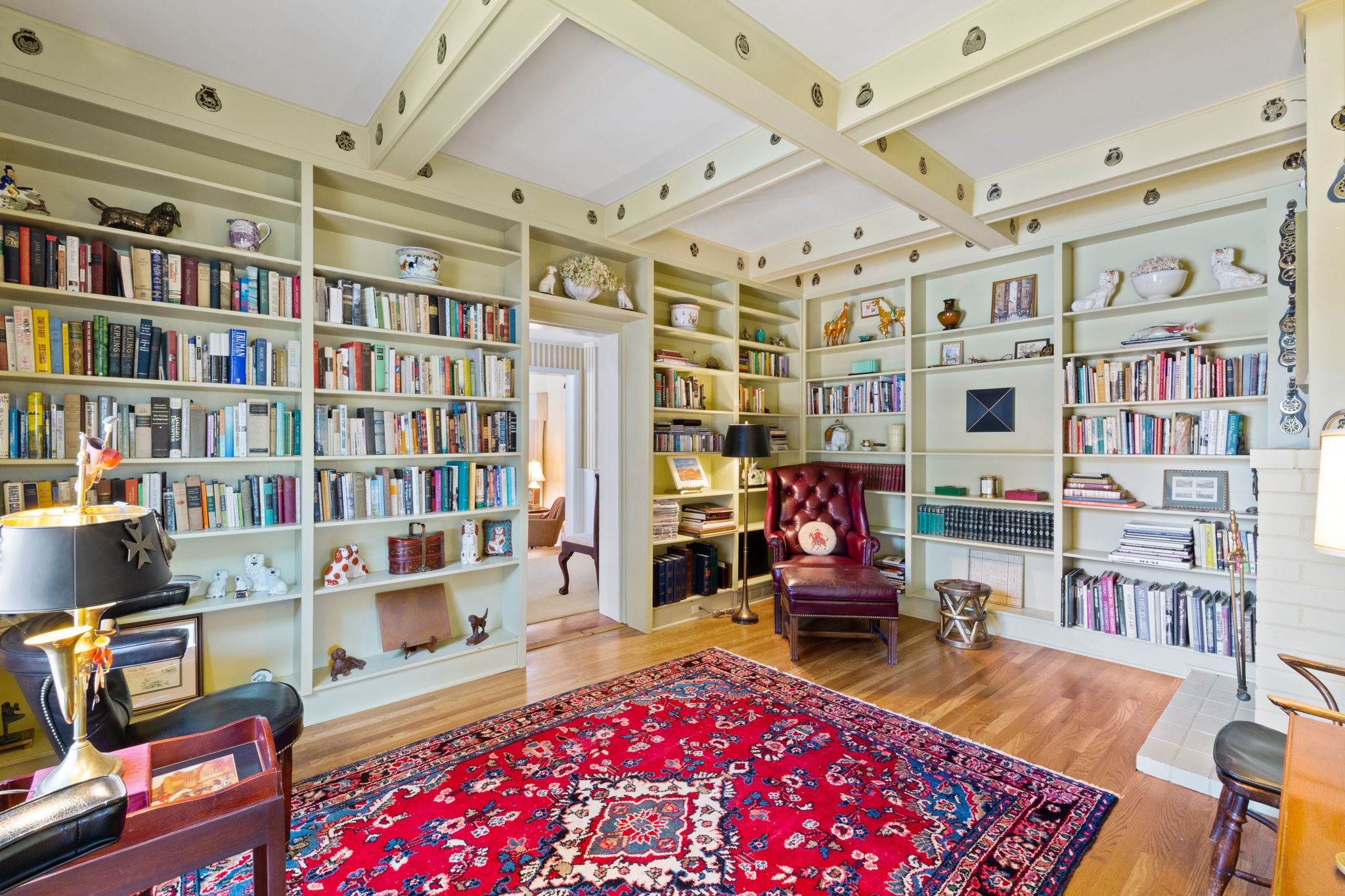 Library with wood burning fireplace and built in book shelves