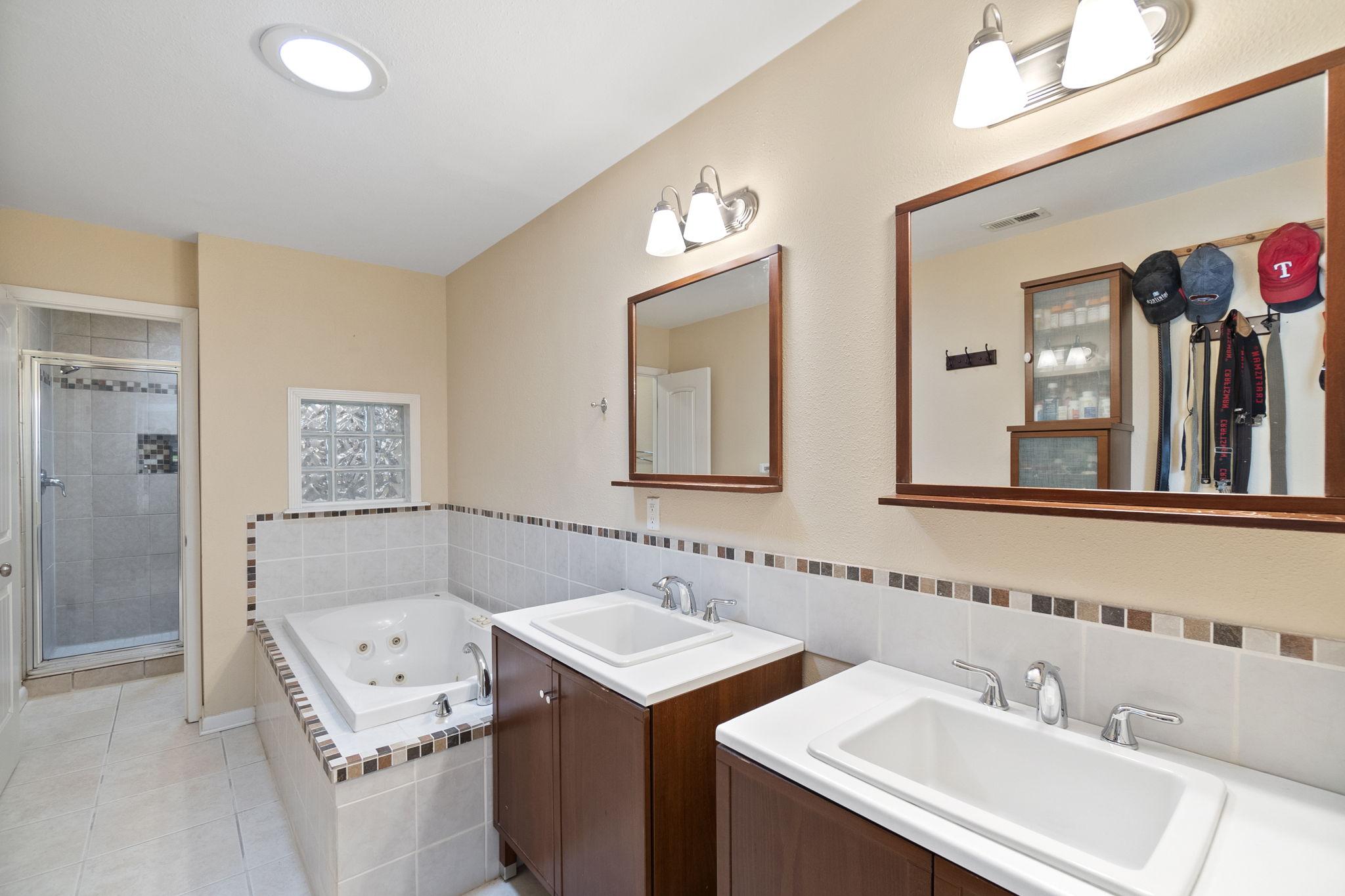 Main bathroom with dual vanities