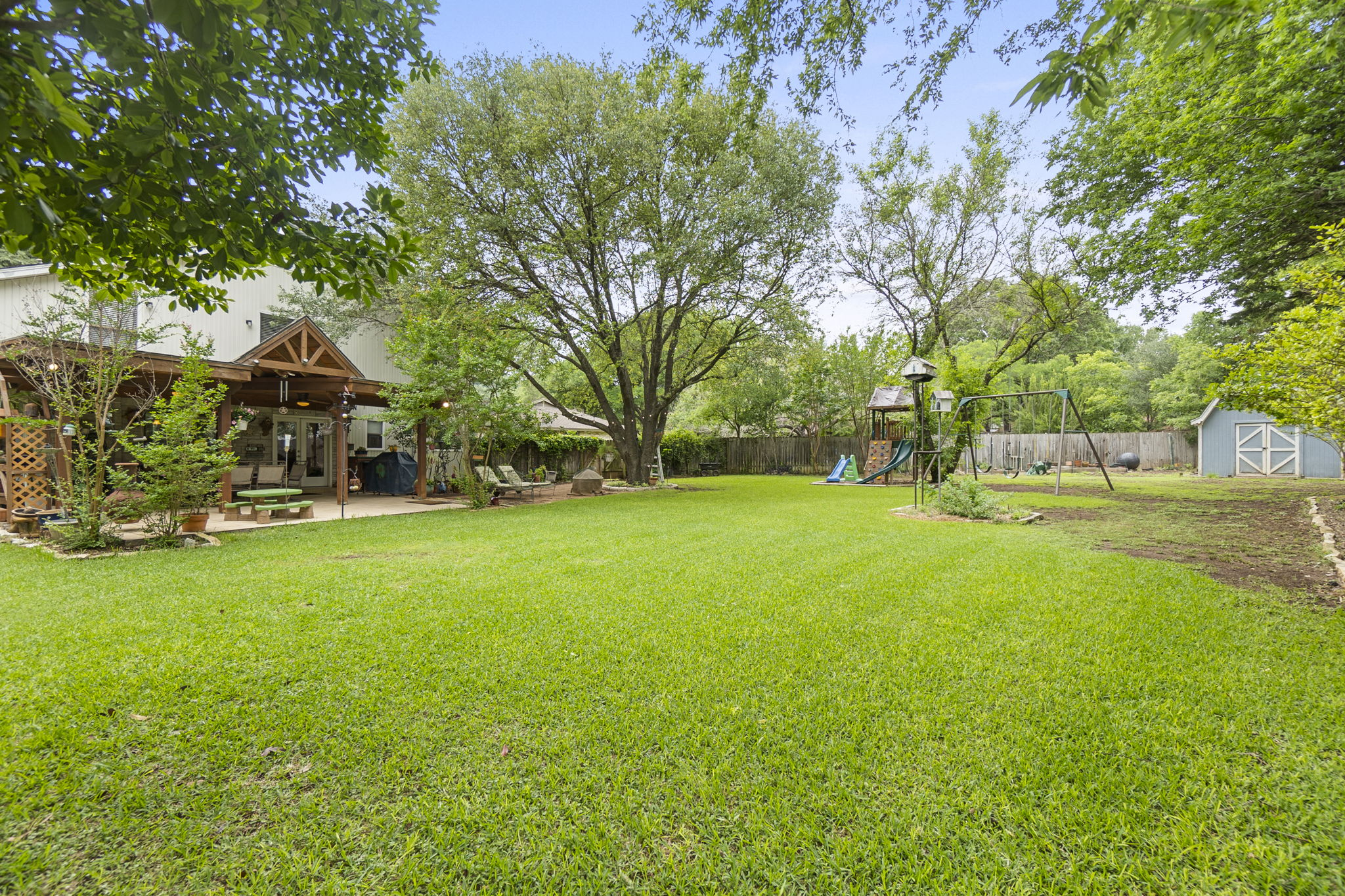 Lush grass, shows room for pool and a cabana!