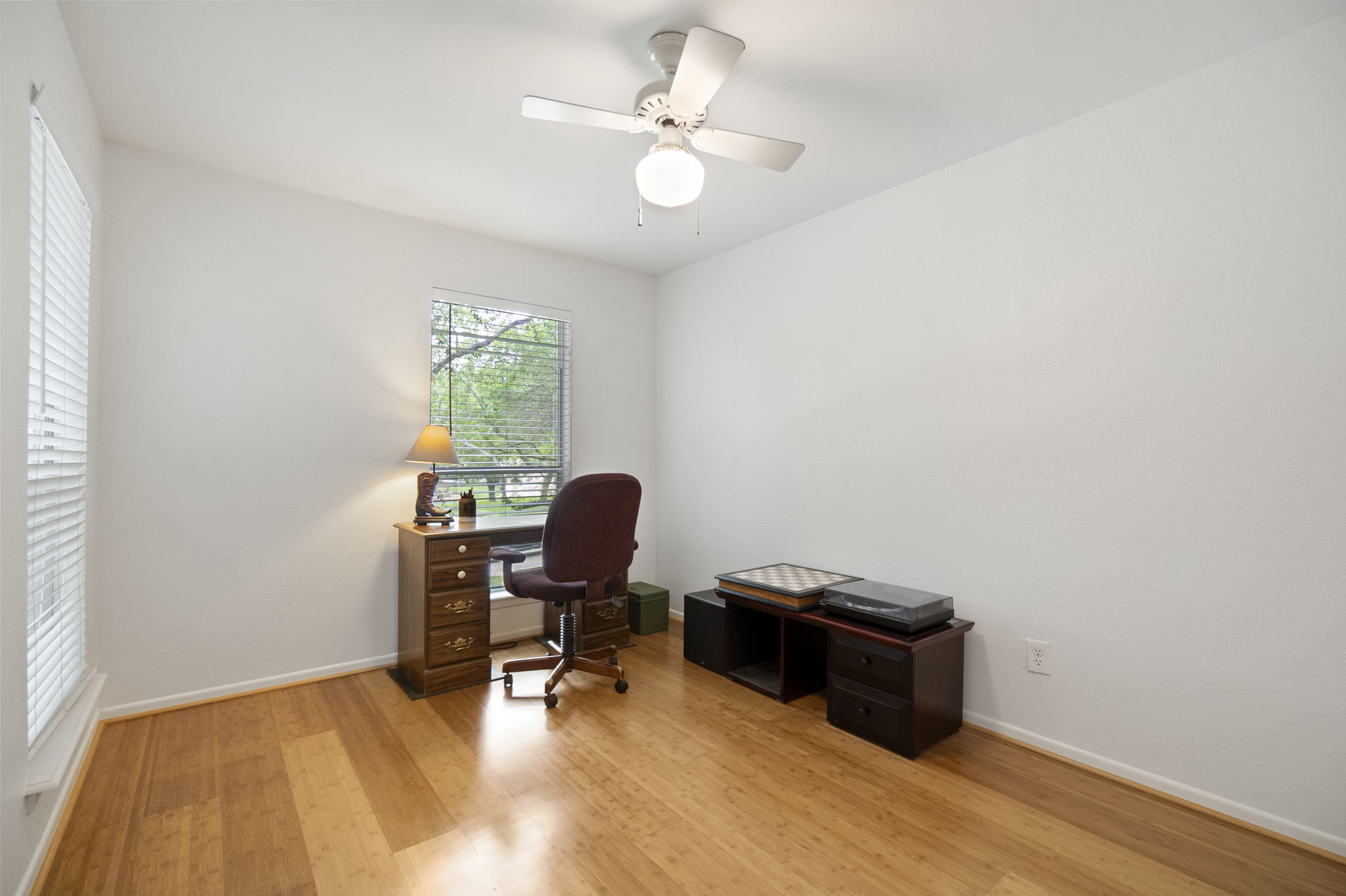 Third bedroom with warm colored flooring
