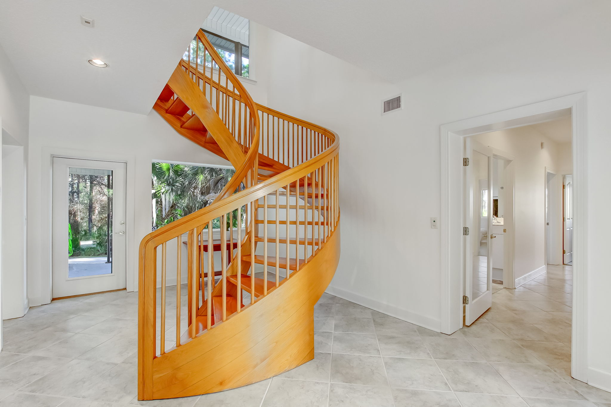 Foyer with Floating Red Oak staircase