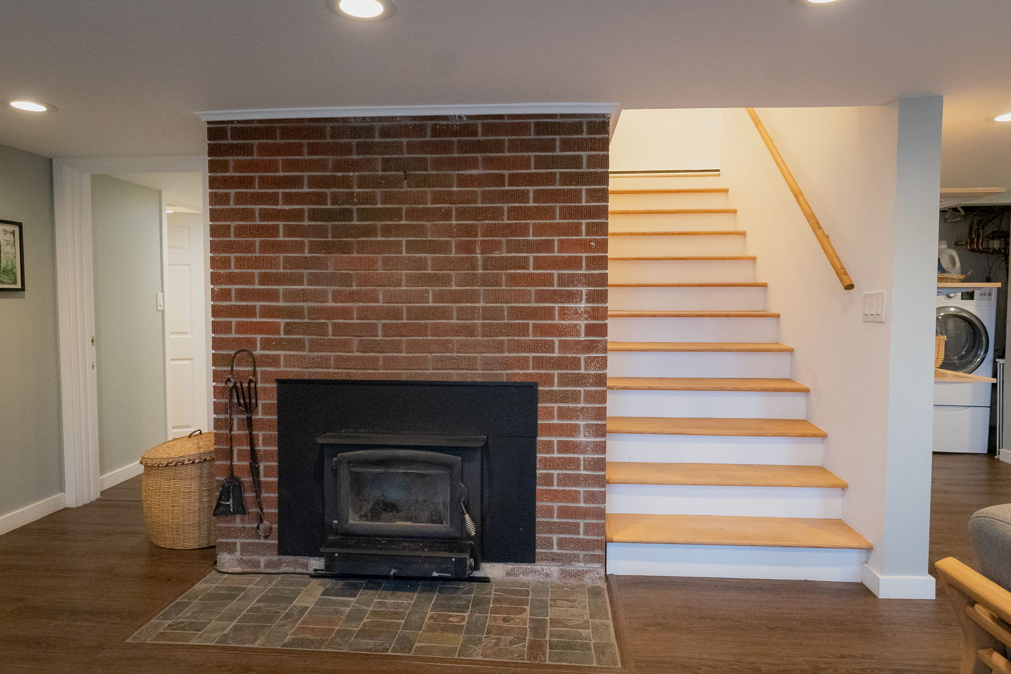 Beautiful brick fireplace with new energy efficient wood insert and chimney liner installed 2014.  Keeps home so warm and cozy.