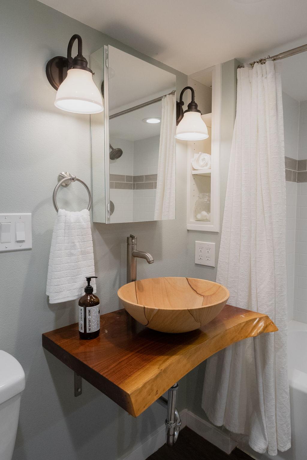 Custom handmade live edge vanity in primary bathroom.