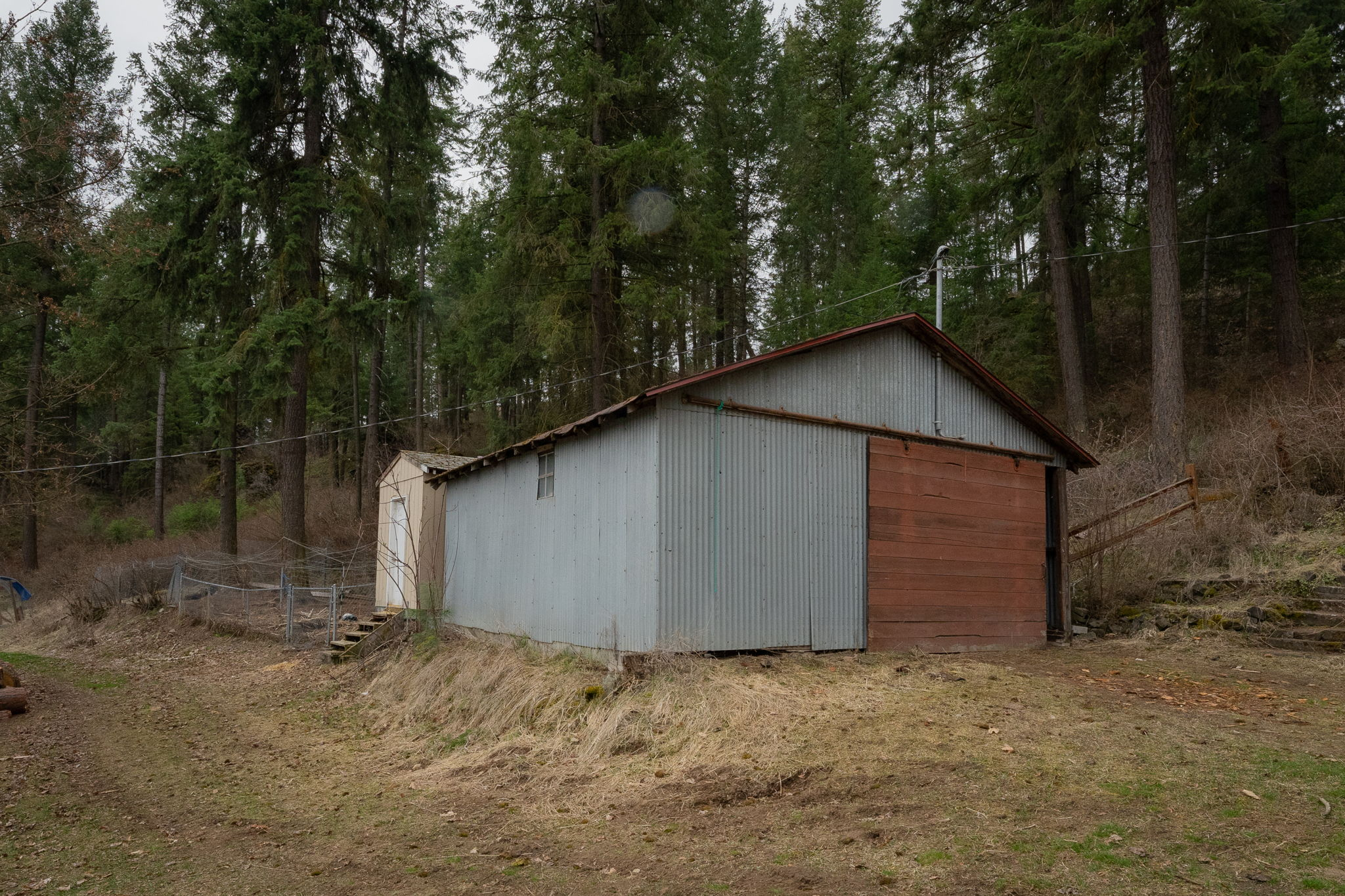 Detached Garage Area and storage building.  Works well for Truck parking.