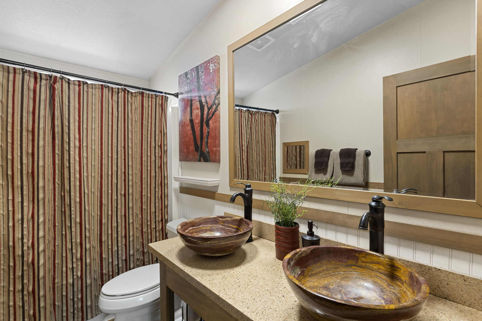 Hall bathroom with shower/tub and vanity with 2 beautiful vessel sinks!
