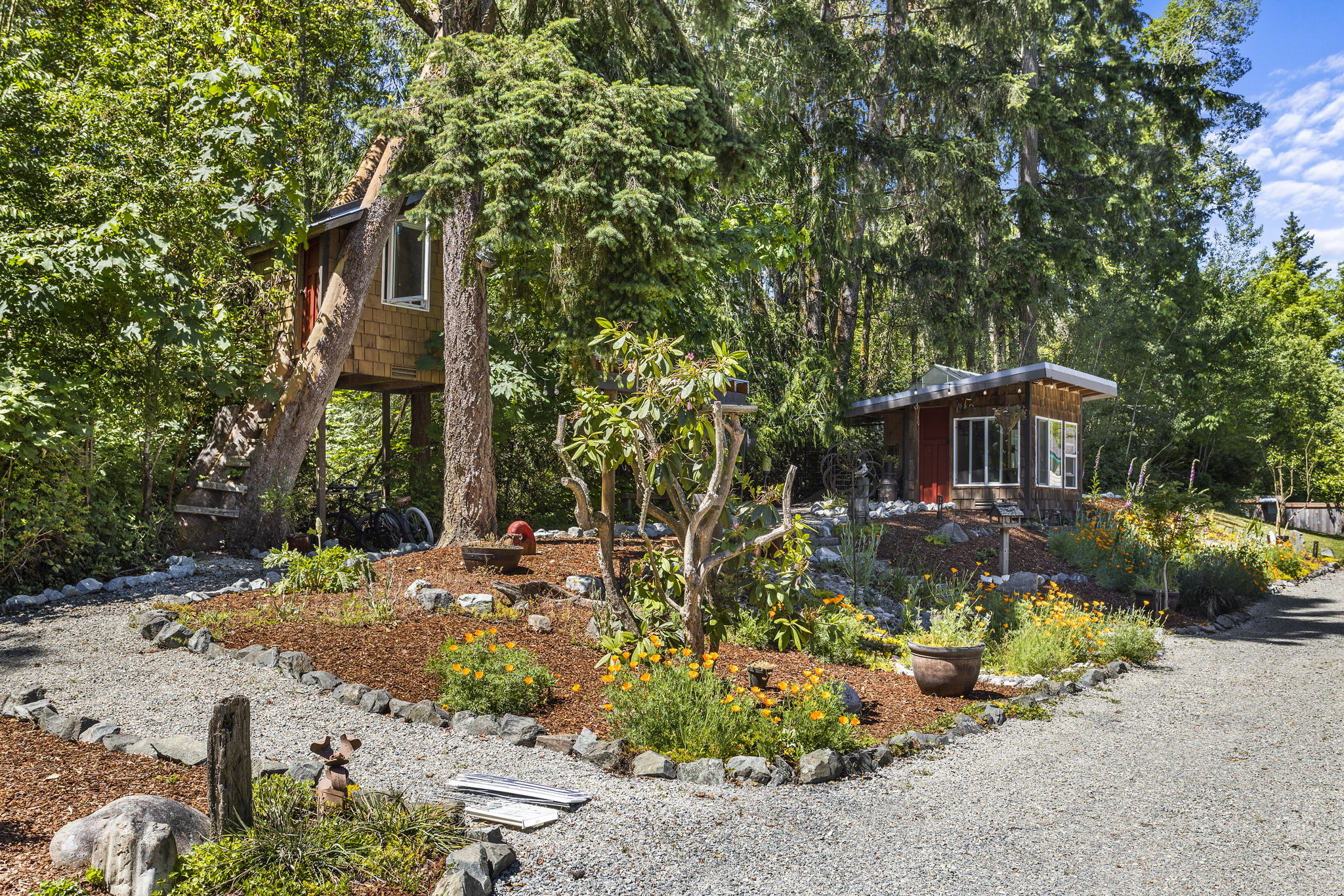 Beautiful gardens and trees throughout the property!