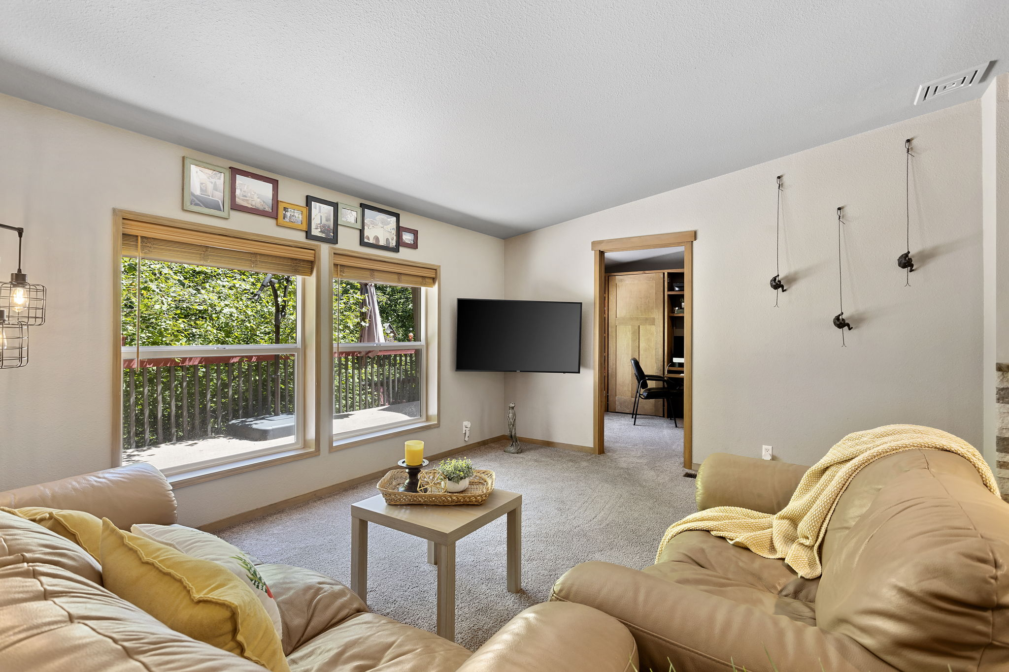 Living room has easy access to home office guest bedroom with custom twin murphy bed/desk!