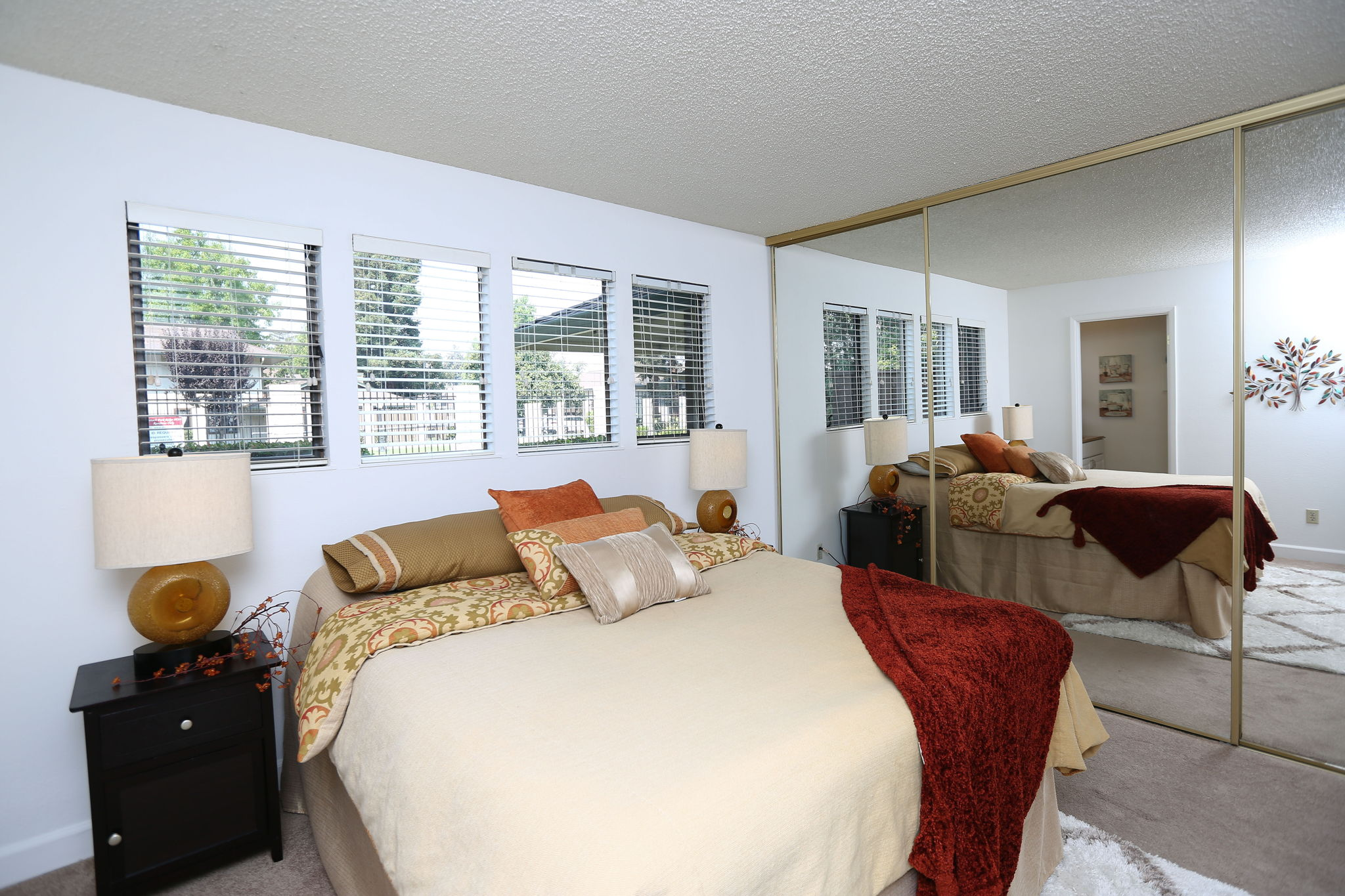 Master bedroom with lots of windows and full wall closet