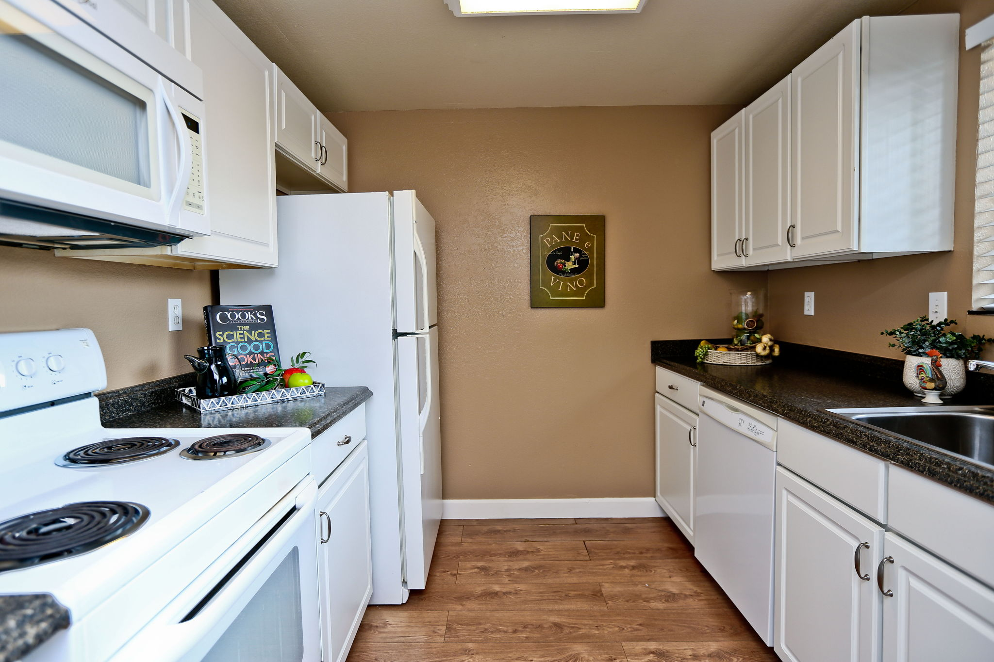 Kitchen with refrigerator, range, microwave