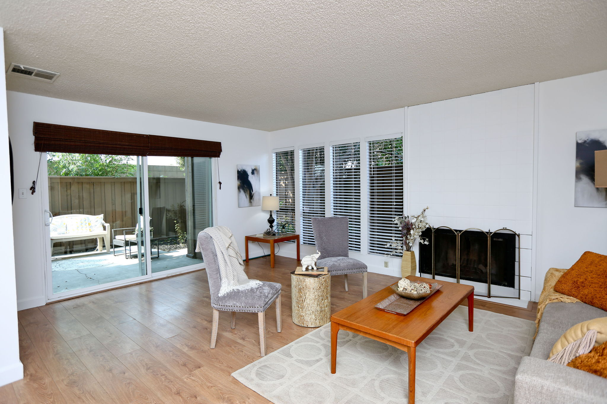 Light, bright living room with slider to patio & storage