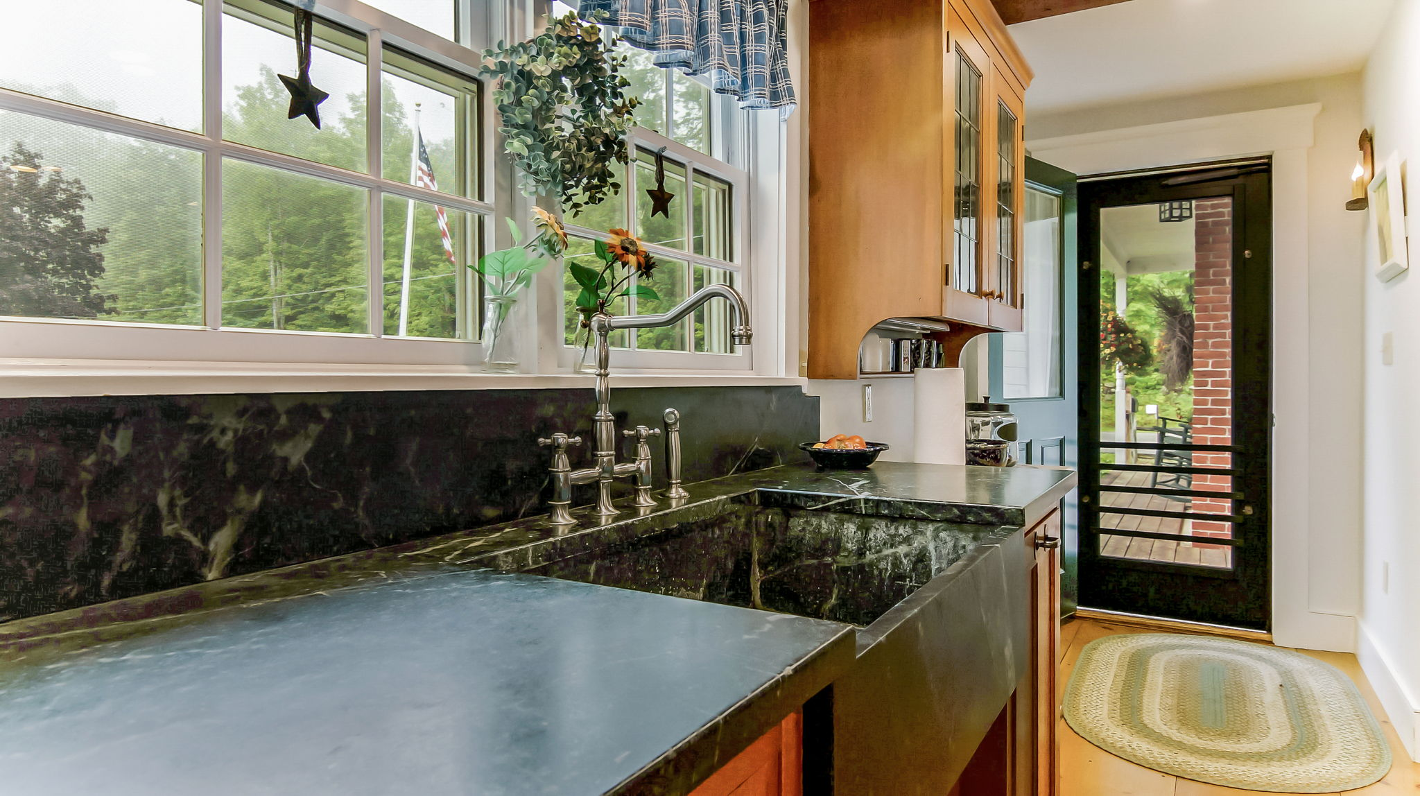 Traditional Soapstone Counter and Farm Sink