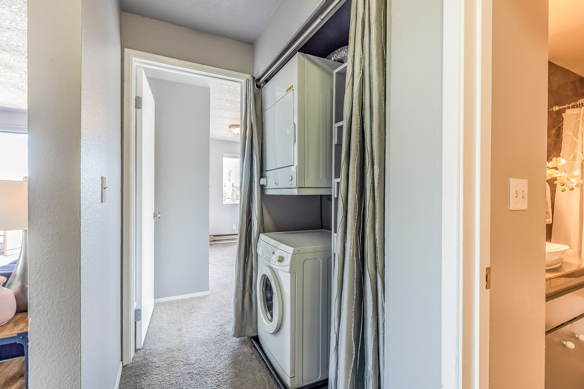 In unit washer and dryer with shelf space