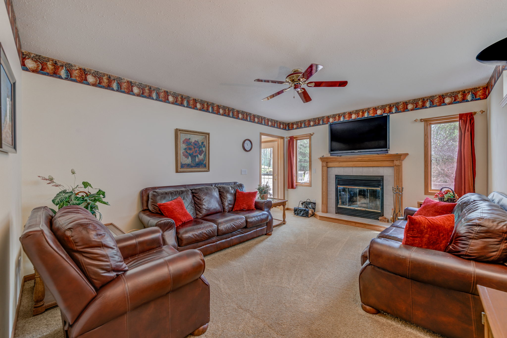 Lower level family room with wood burning fireplace