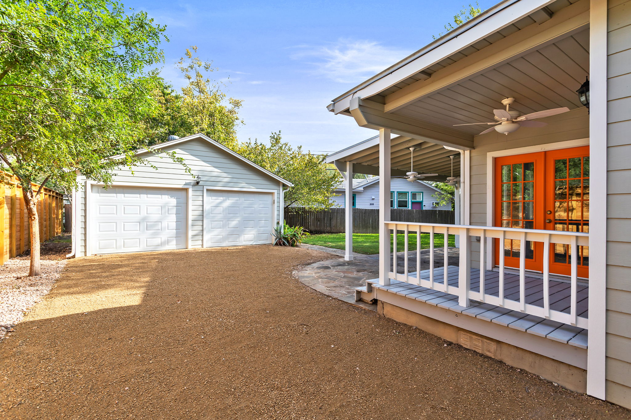 Back porch leads to detached 2-car garage