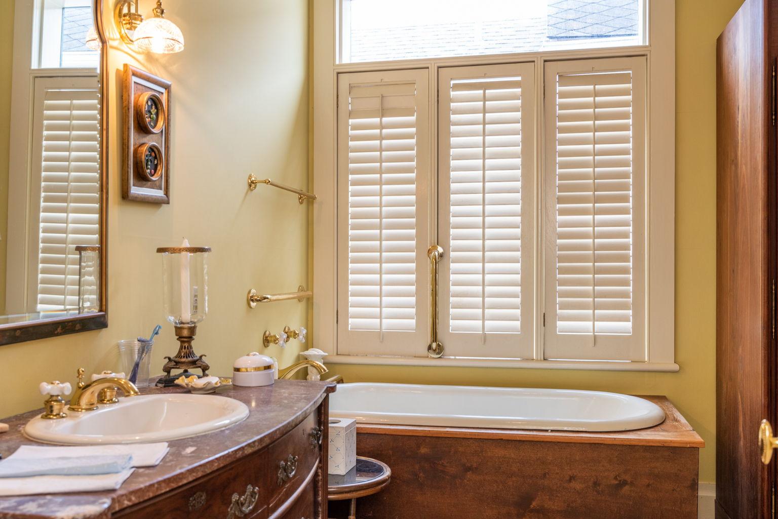 And a charming private bath with unique bathtub