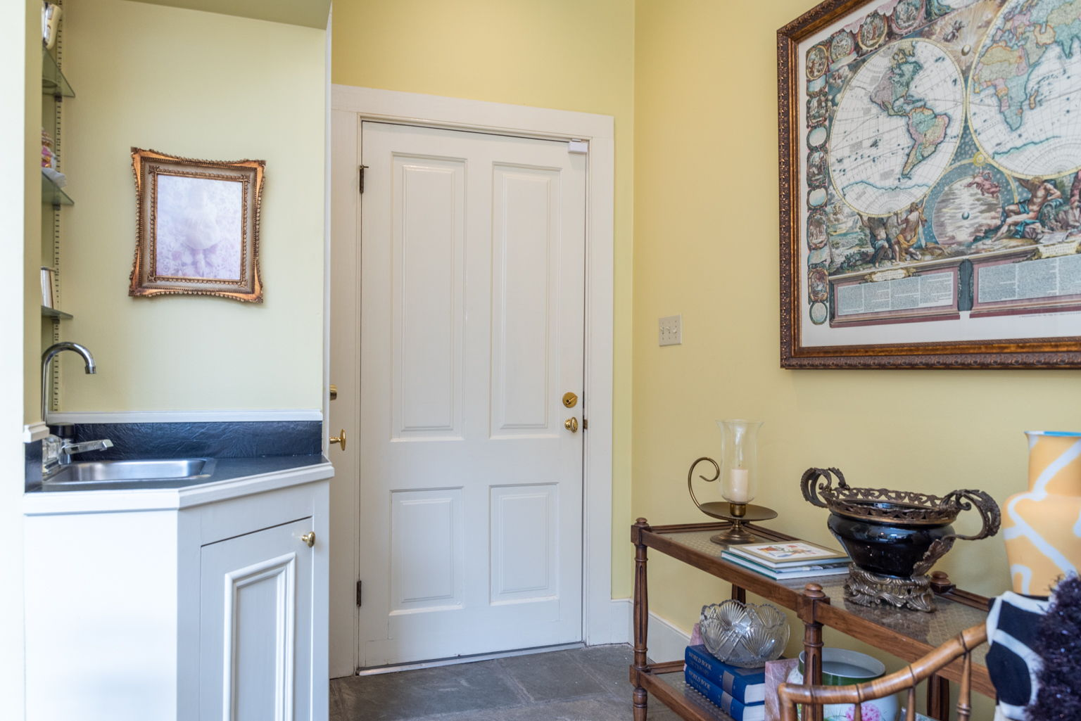 The downstairs powder room off the hallway