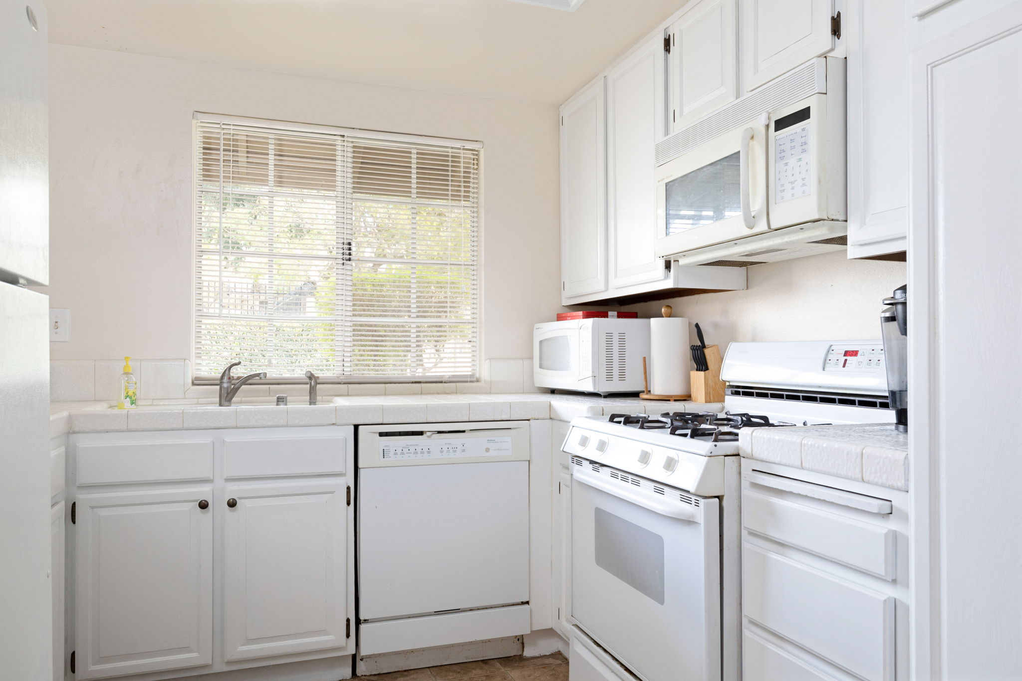 Newly painted cabinets in sparkling kitchen