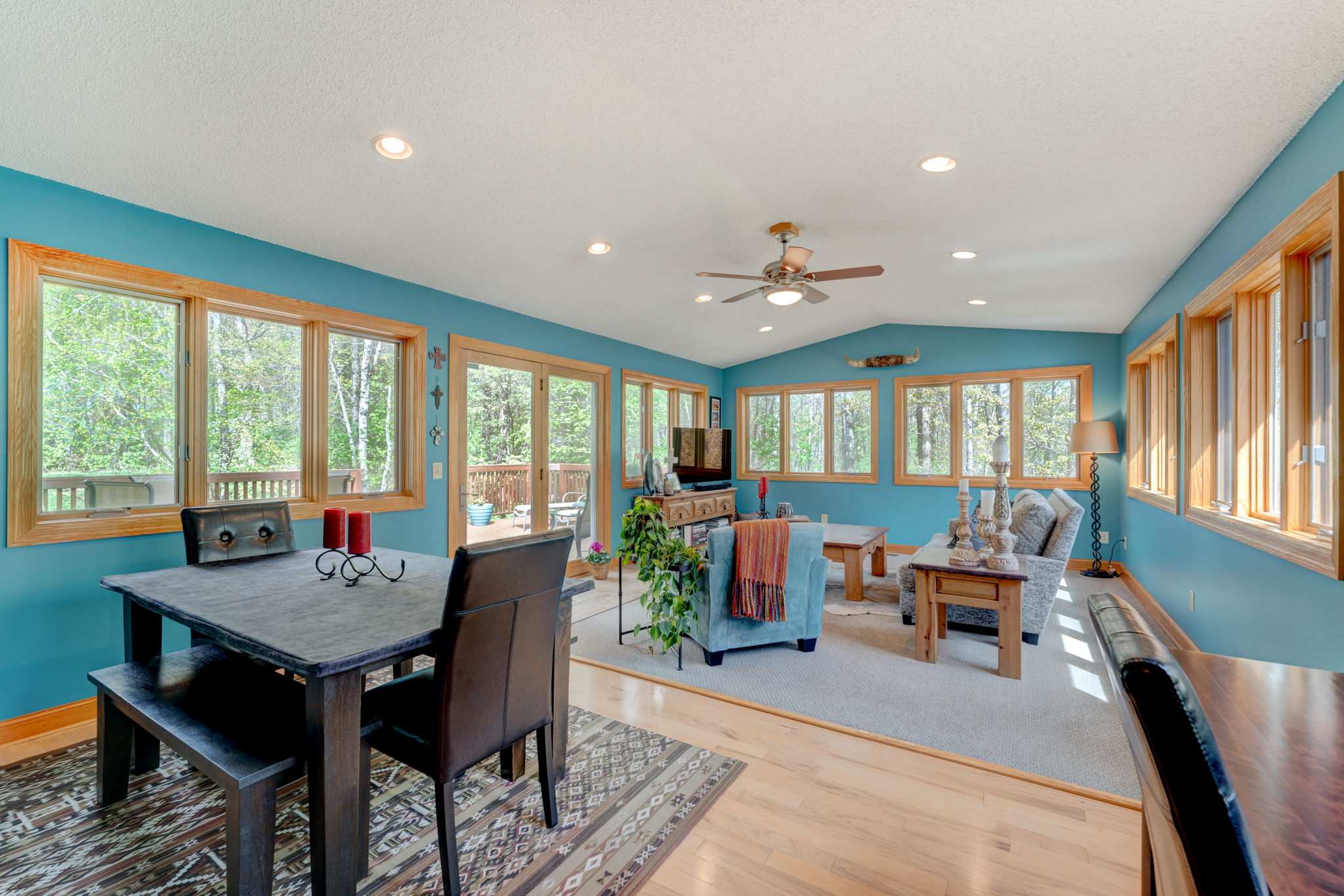 Beautiful, Spacious Sun Room with eating area, opens to deck