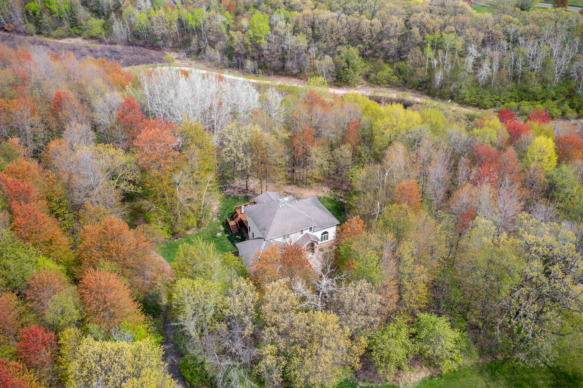 Aerial shot of wooded lot and nearby walking trail