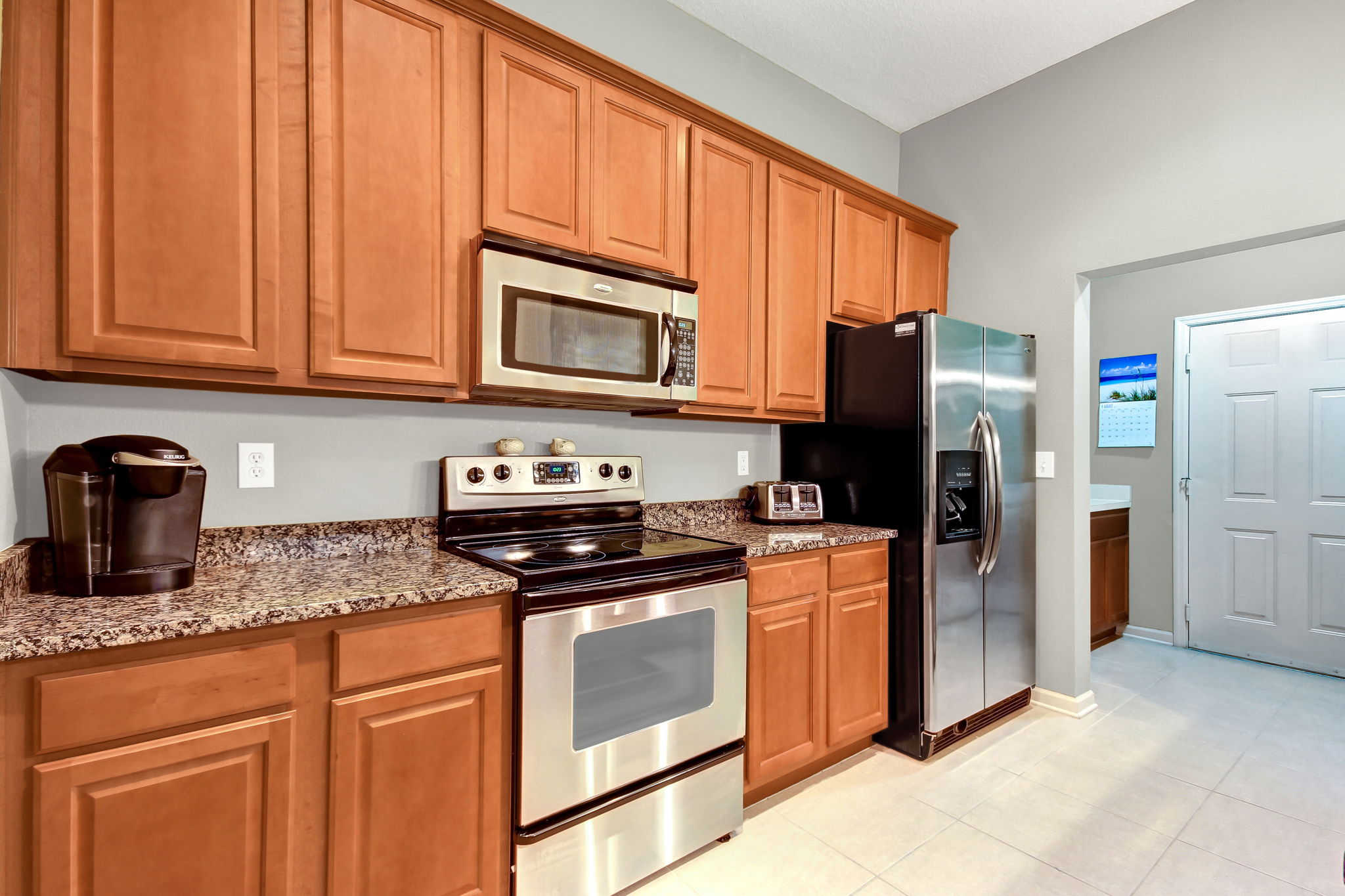 Kitchen opens to butler pantry and utility room