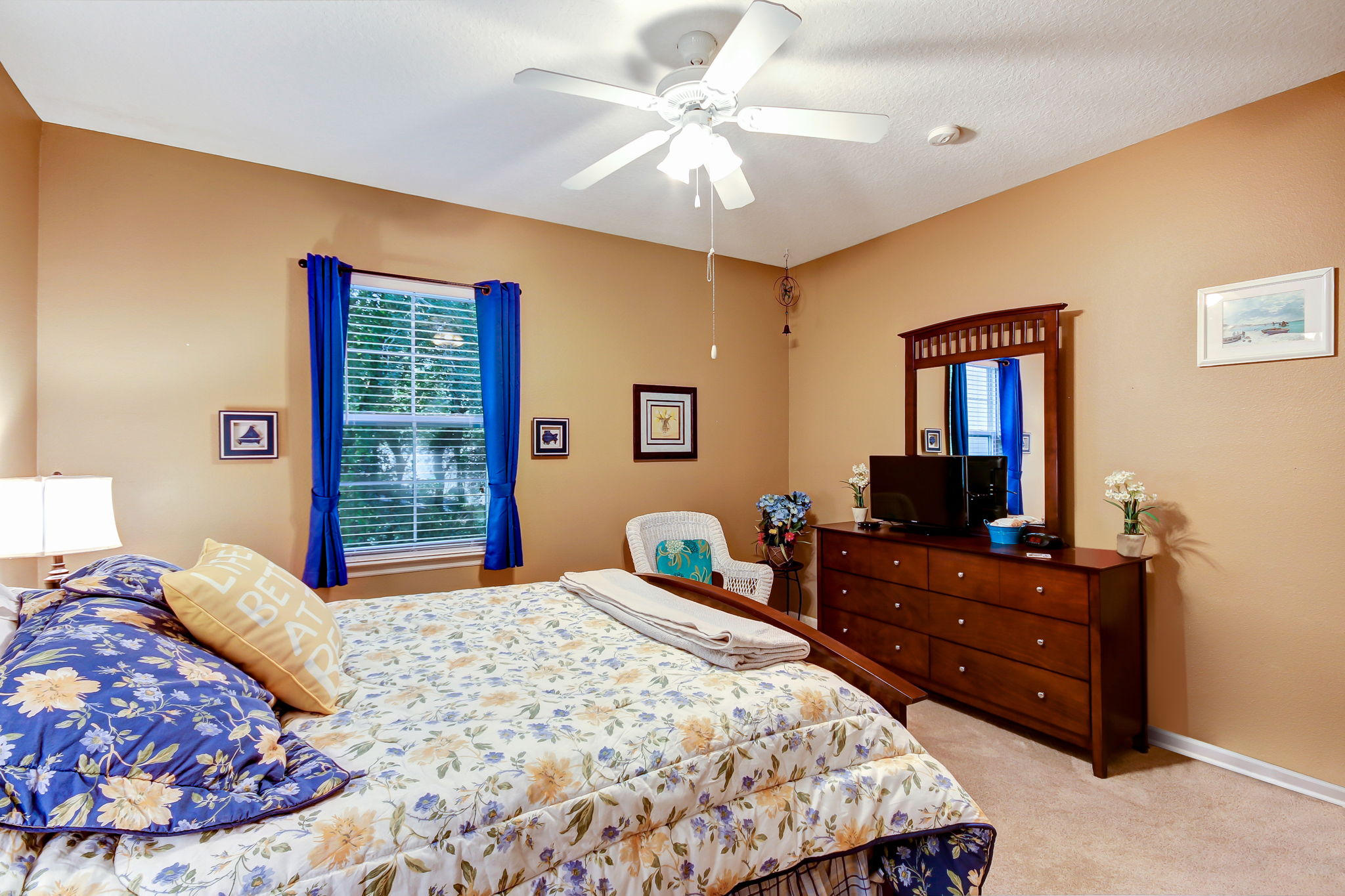Ceiling fans are featured throughout the home