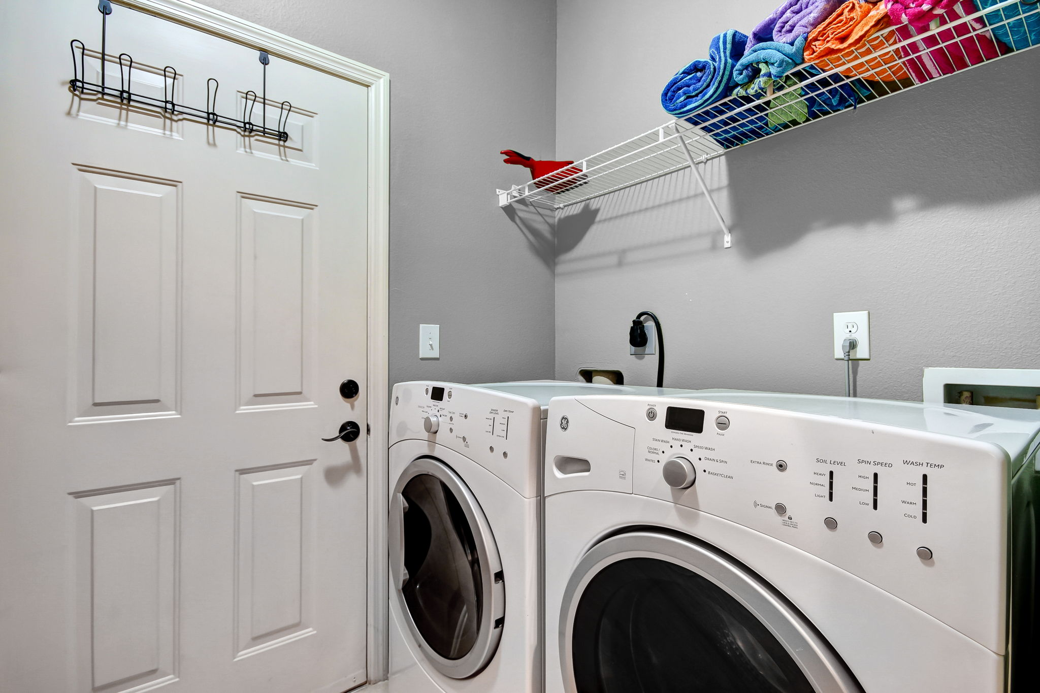 A roomy laundry and storage area