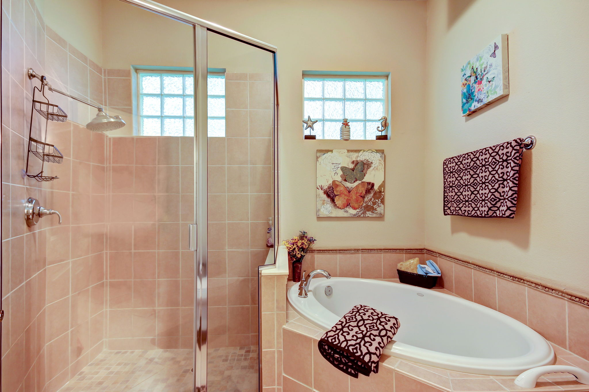 Master bath also equipped with garden tub and glass enclosed shower