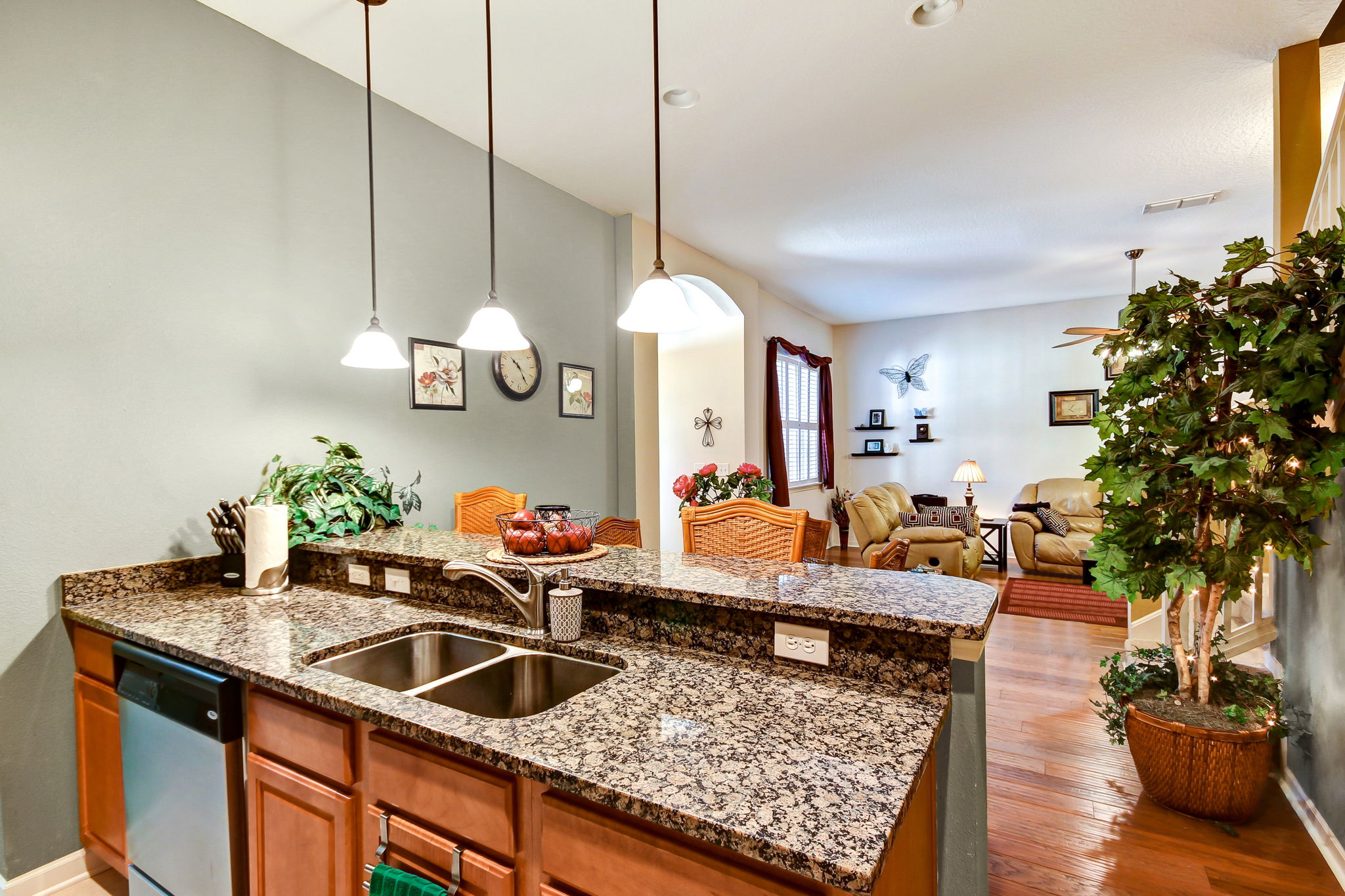 """Updated kitchen with granite countertops, 42"""" cabinets and stainless steel appliances"""