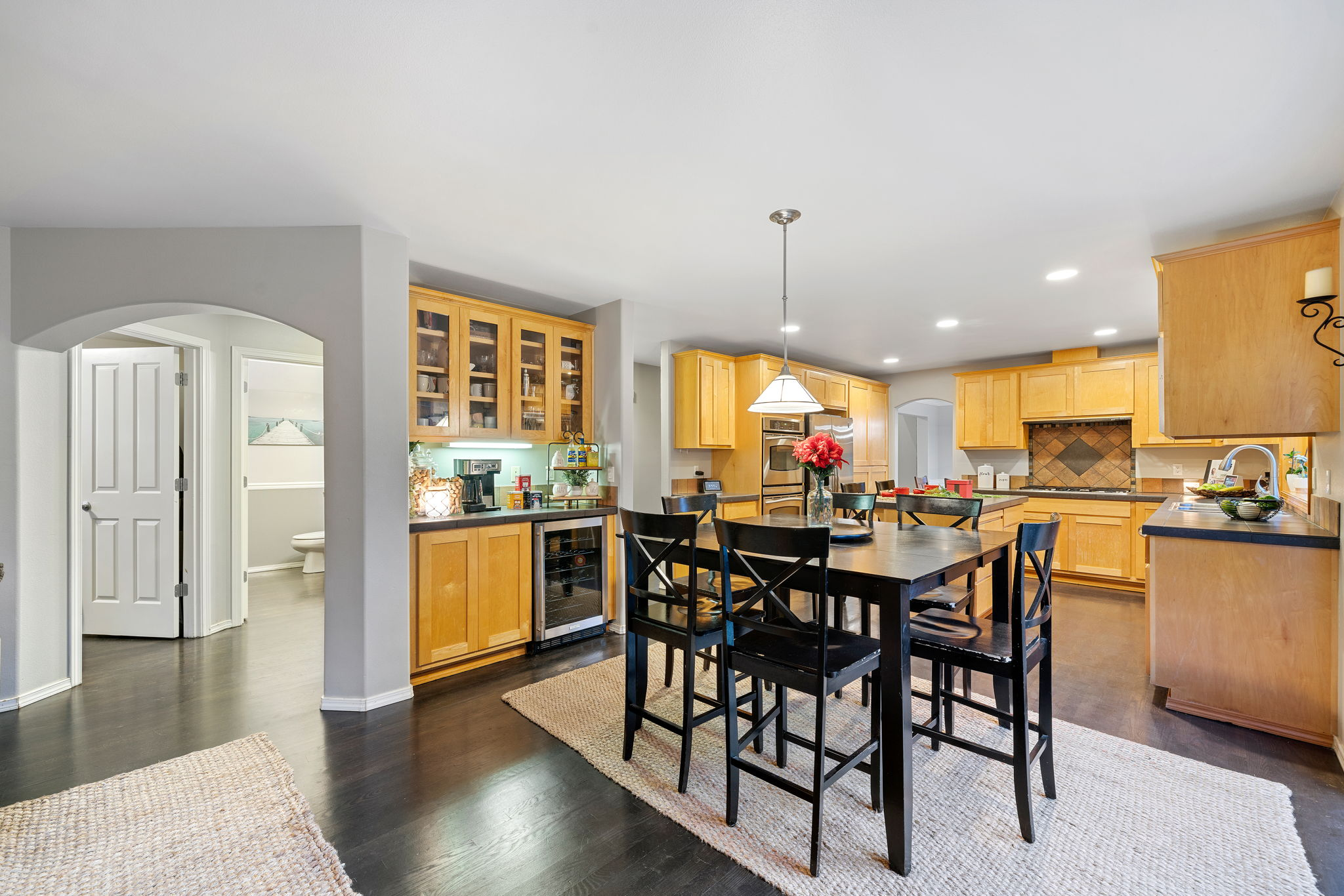Great butlers pantry or bar with built in wine fridge!