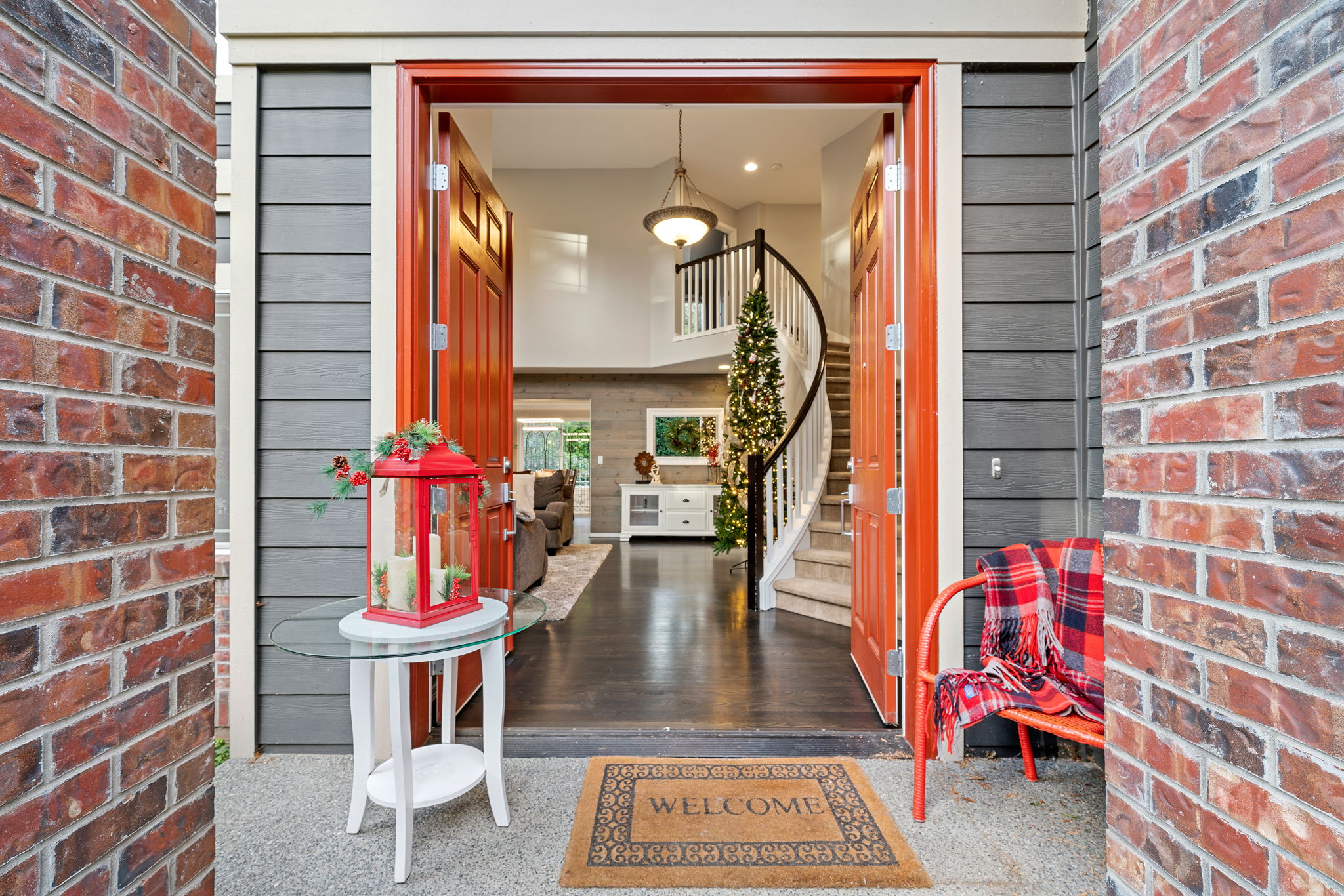 Double door entry welcome you inside this light filled vaulted entry!