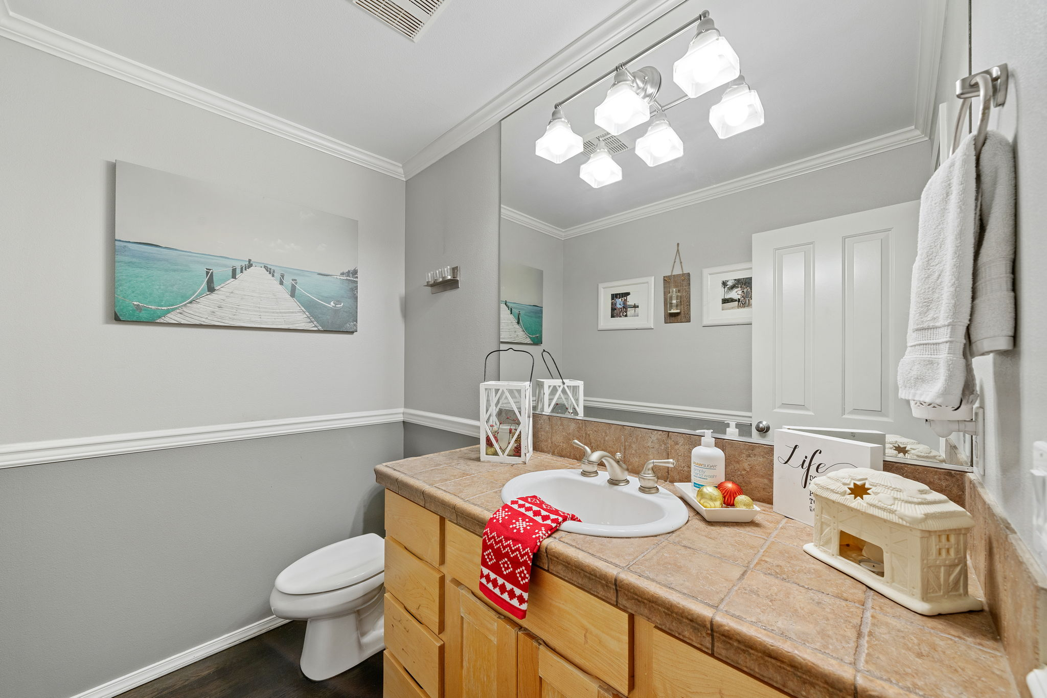 Powder room on the main floor close to the family room and office/flax space