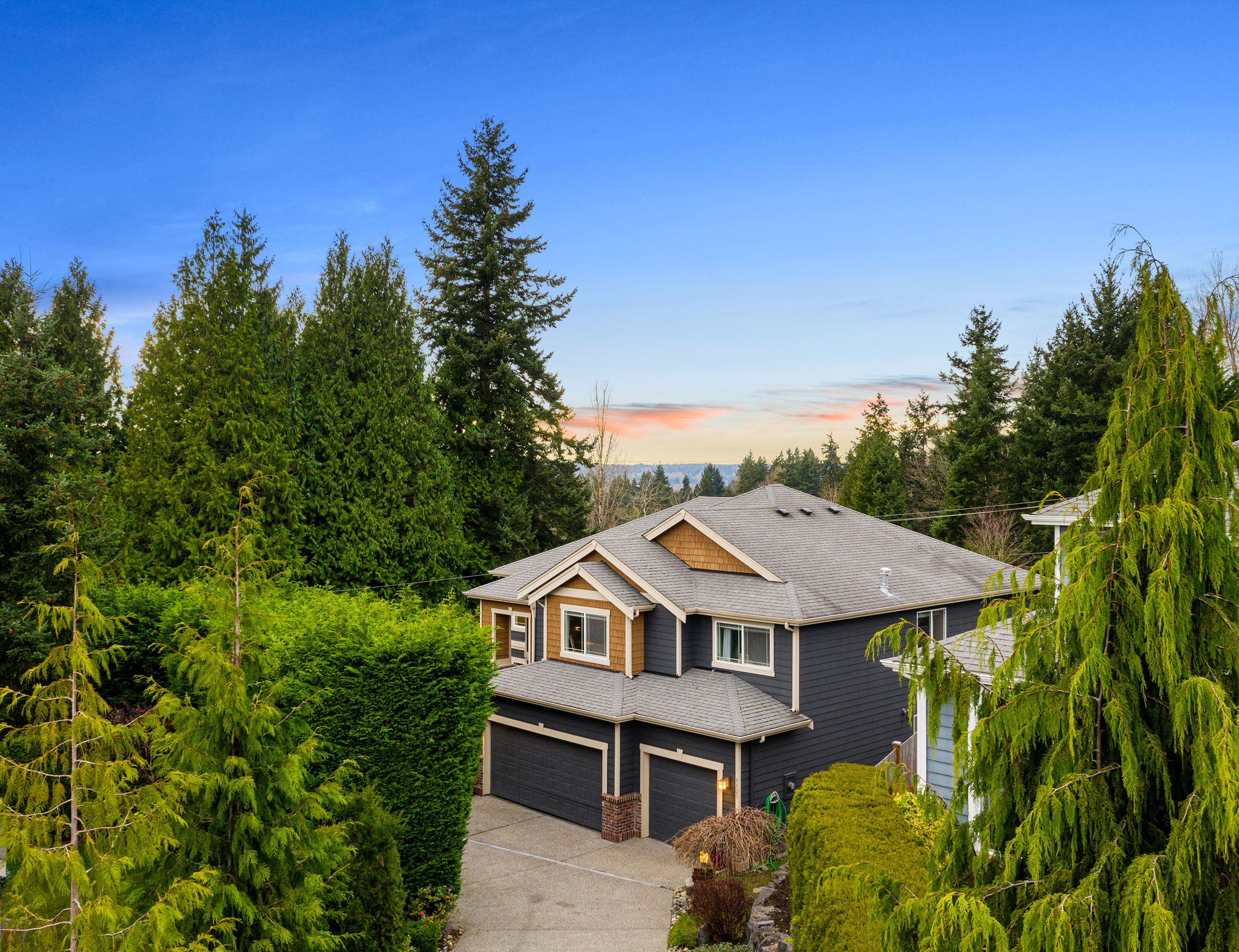 Tree lined private driveway leads to your home!