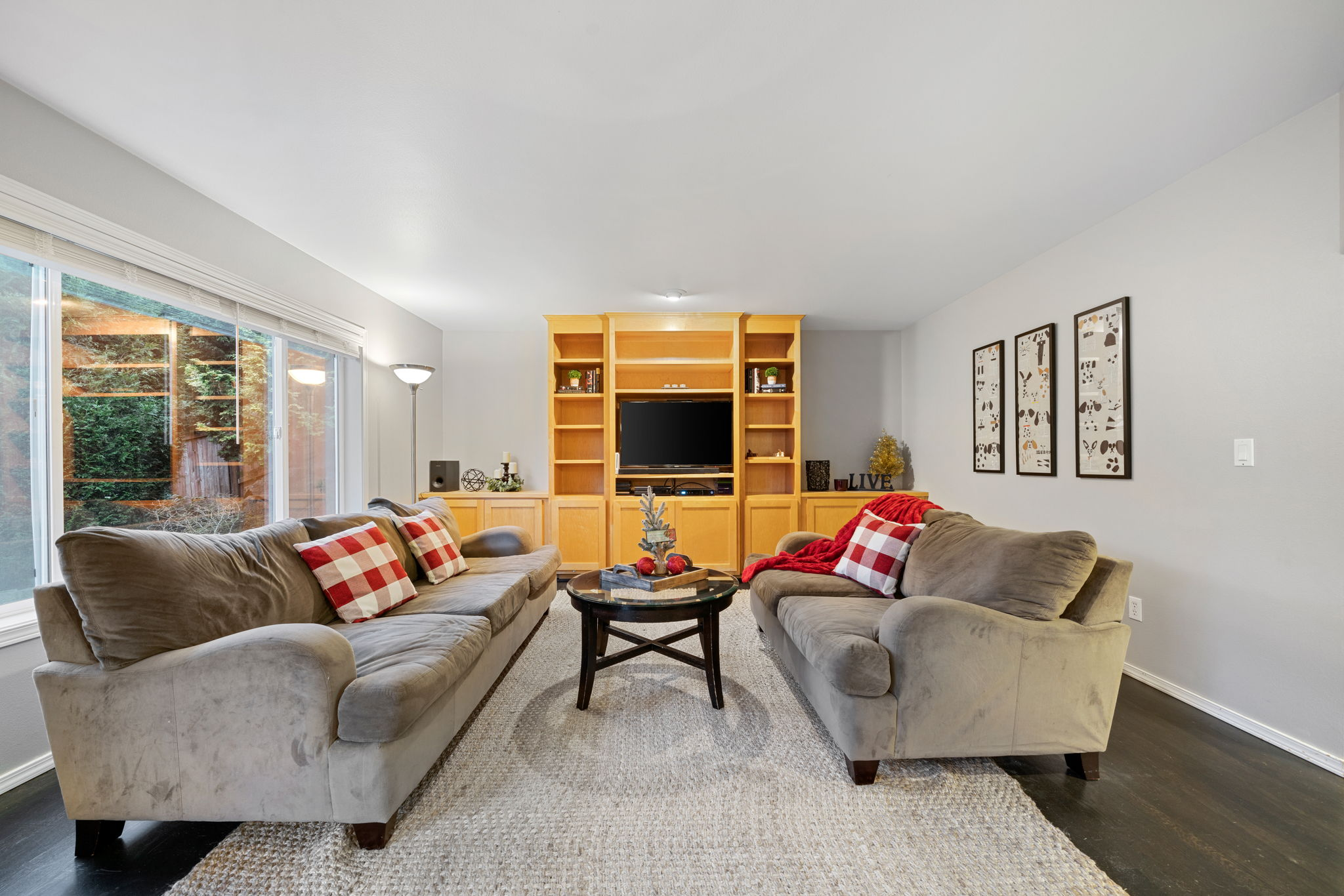 Family room is large and has build in custom cabinetry. Great location for your art, books, and your tv of course!