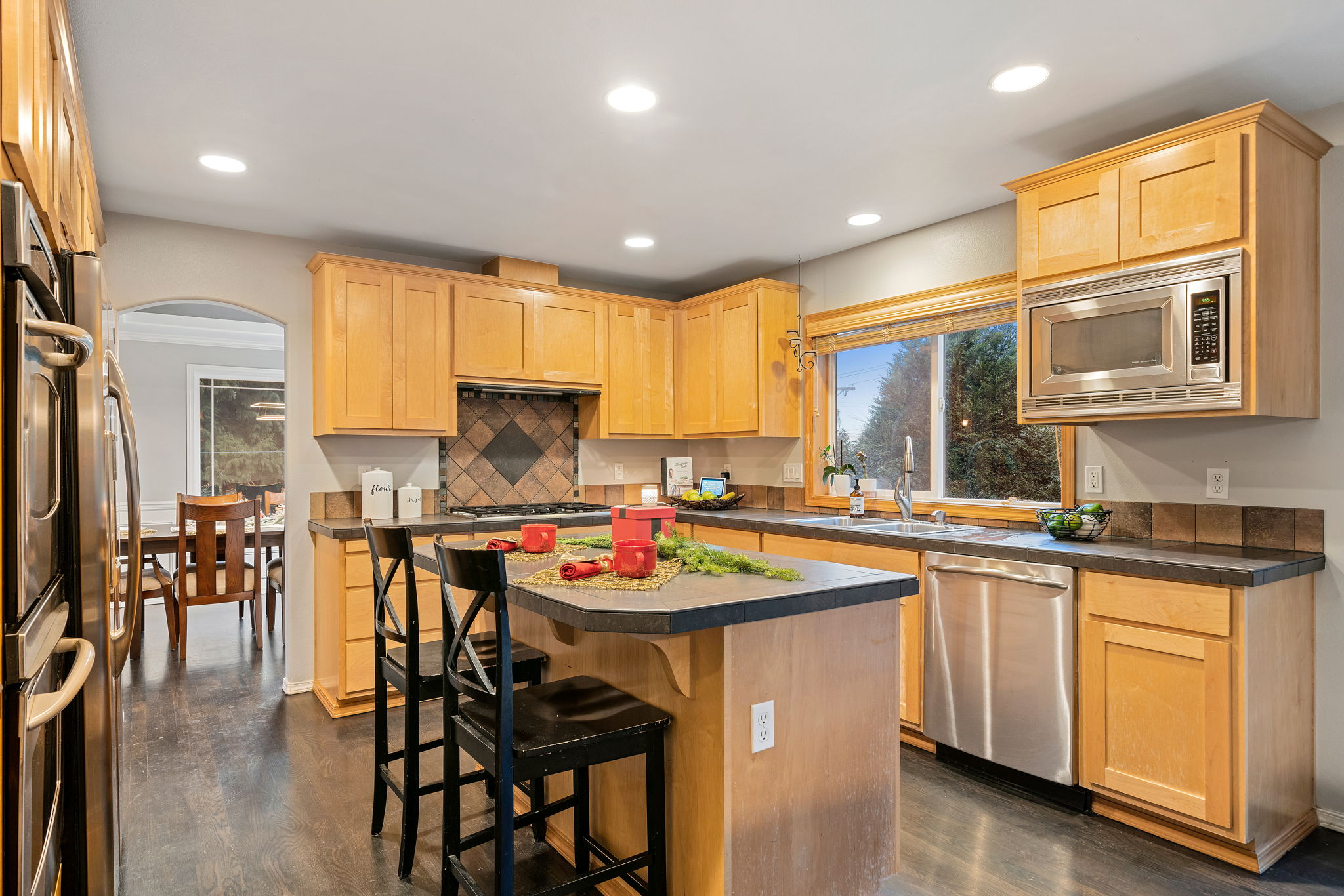 Chefs dream kitchen with double ovens and island! Stainless steel appliances.