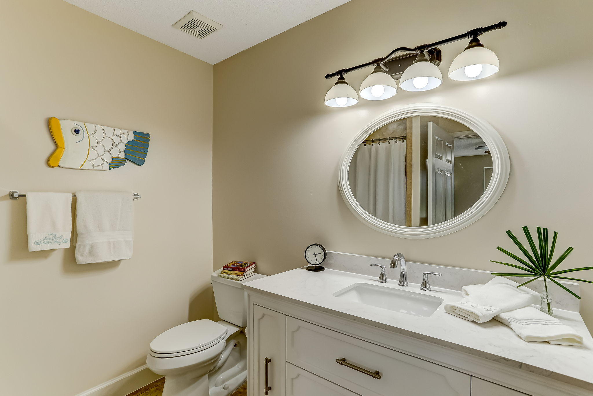 Ensuite master bath with travertine tiled shower