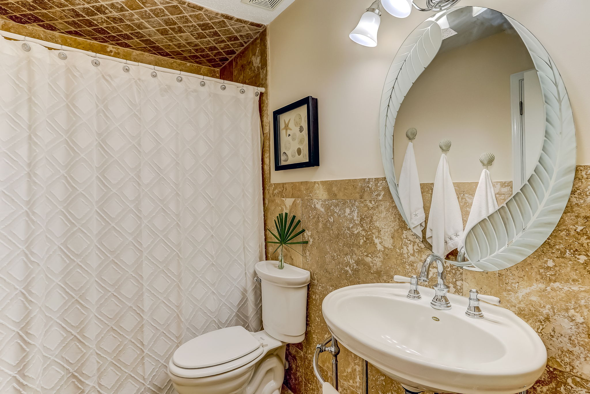 Guest bath with travertine tiled shower