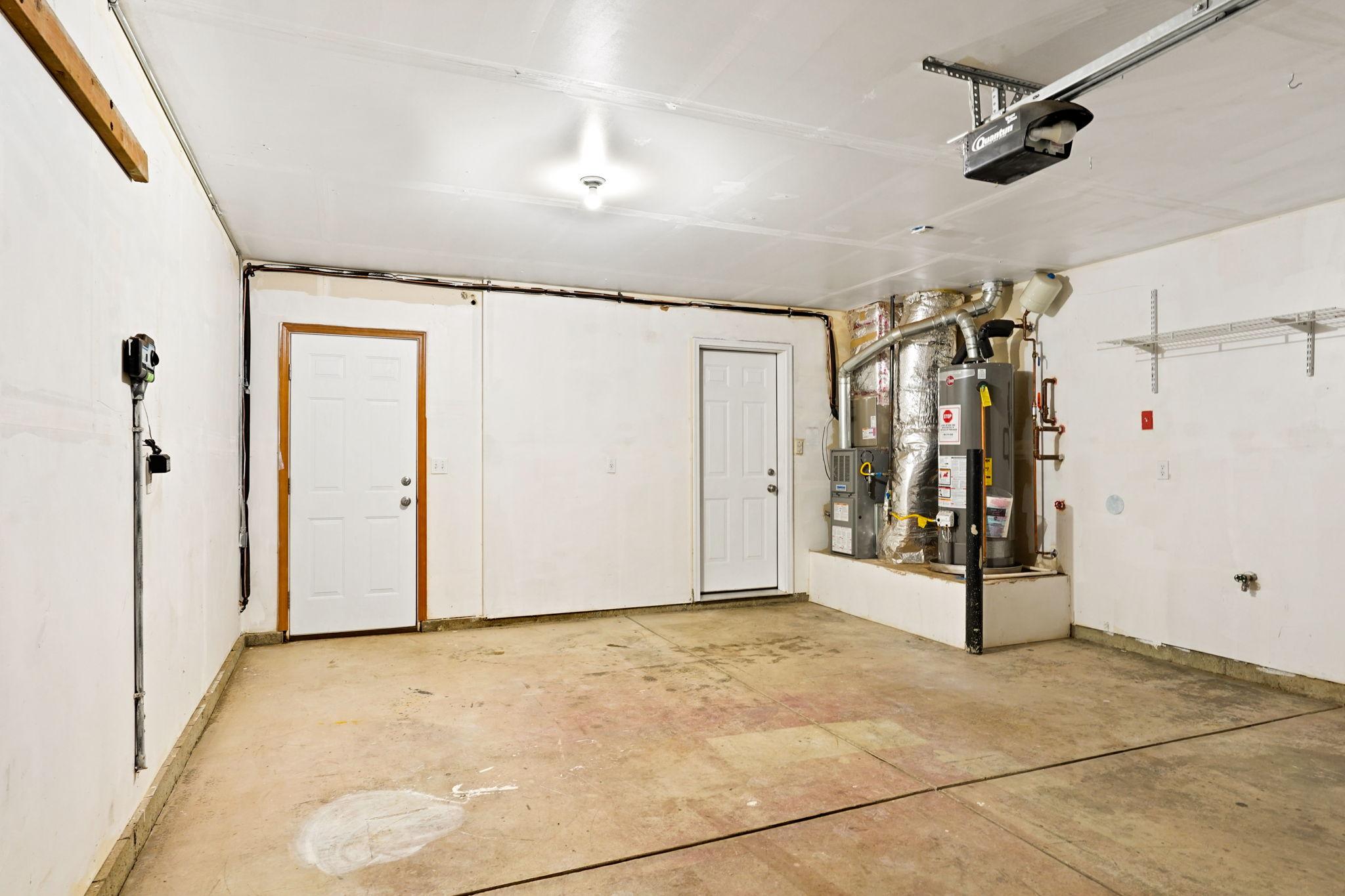 Two car garage w/ door opener