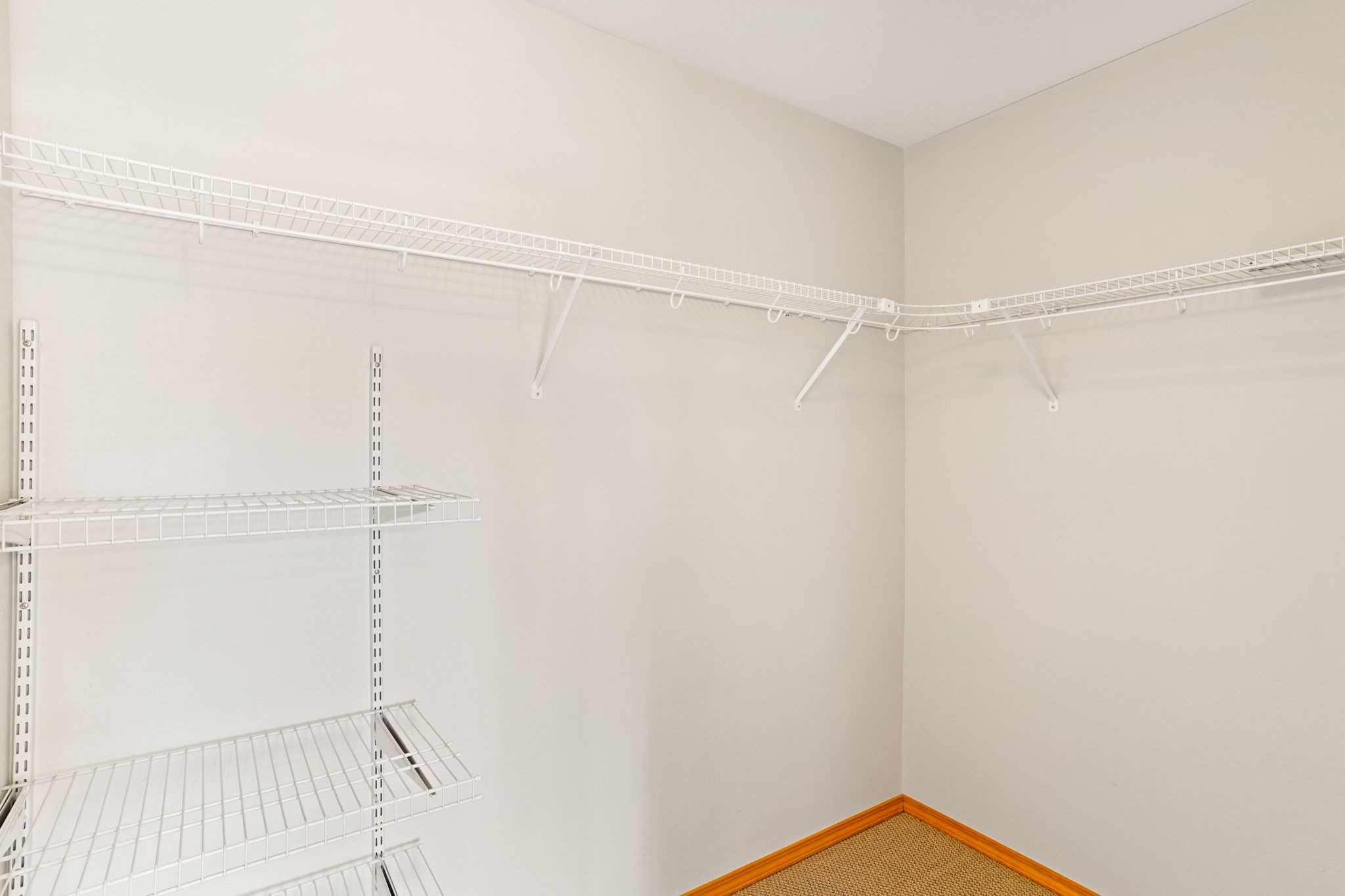 Primary Bedroom walk-in closet
